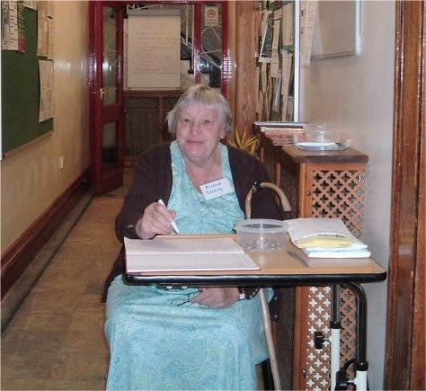 Mildred in charge at the admission desk
